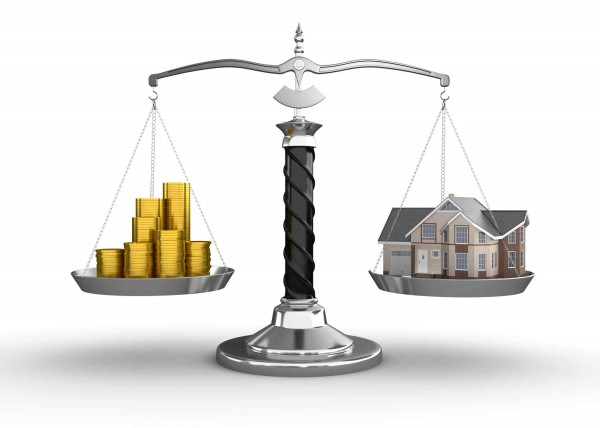 House and money on scale