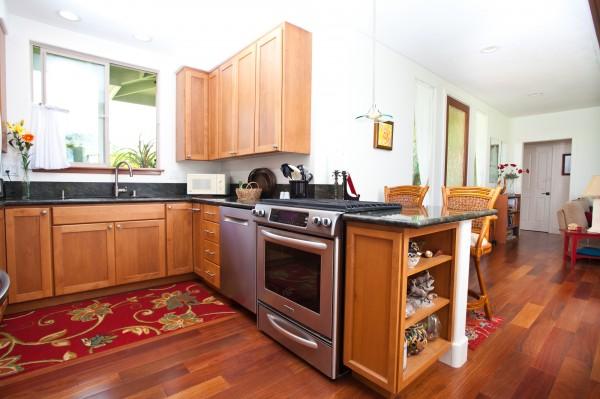 Teak floors, granite counters and vinyl windows/sliders.