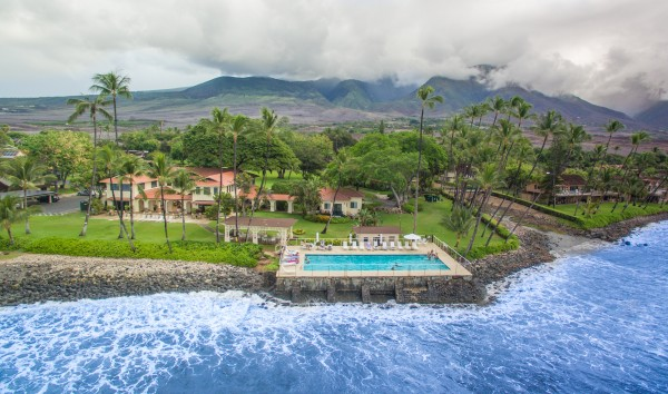 Birds eye view of the Puamana ocean pool , club house and the scenic West Maui Mountains